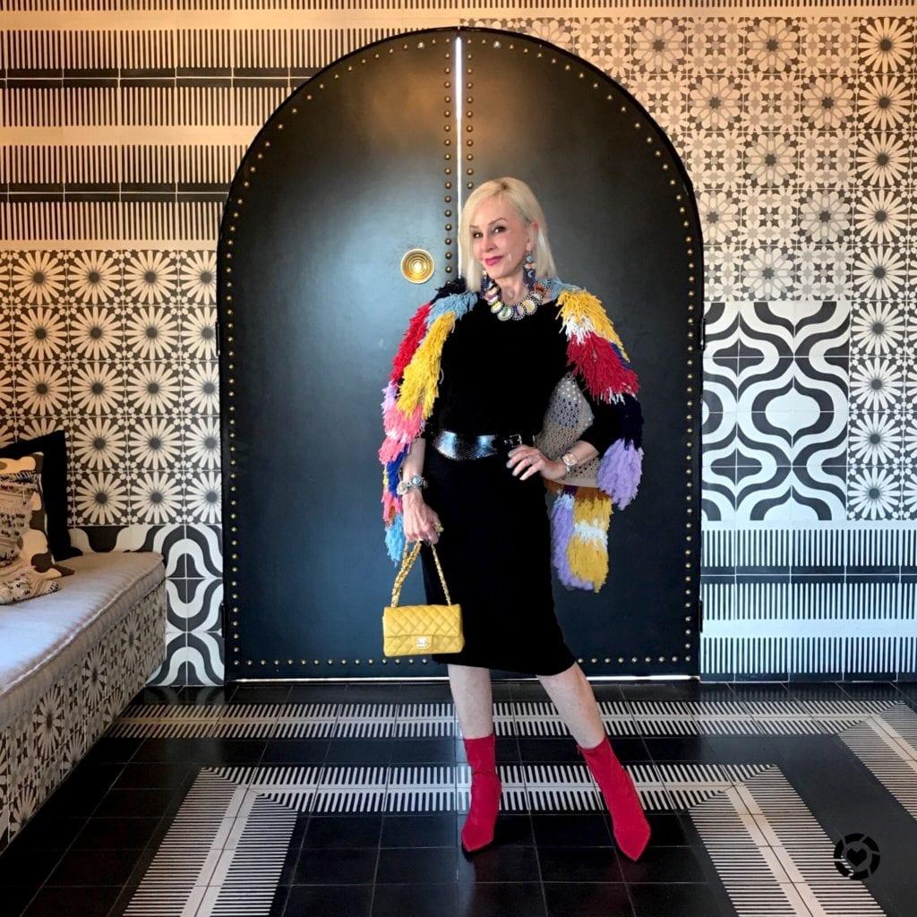 @shesheshow Chico's black dress, travelers dress, red booties, yellow chanel bag, multi fringe jacket