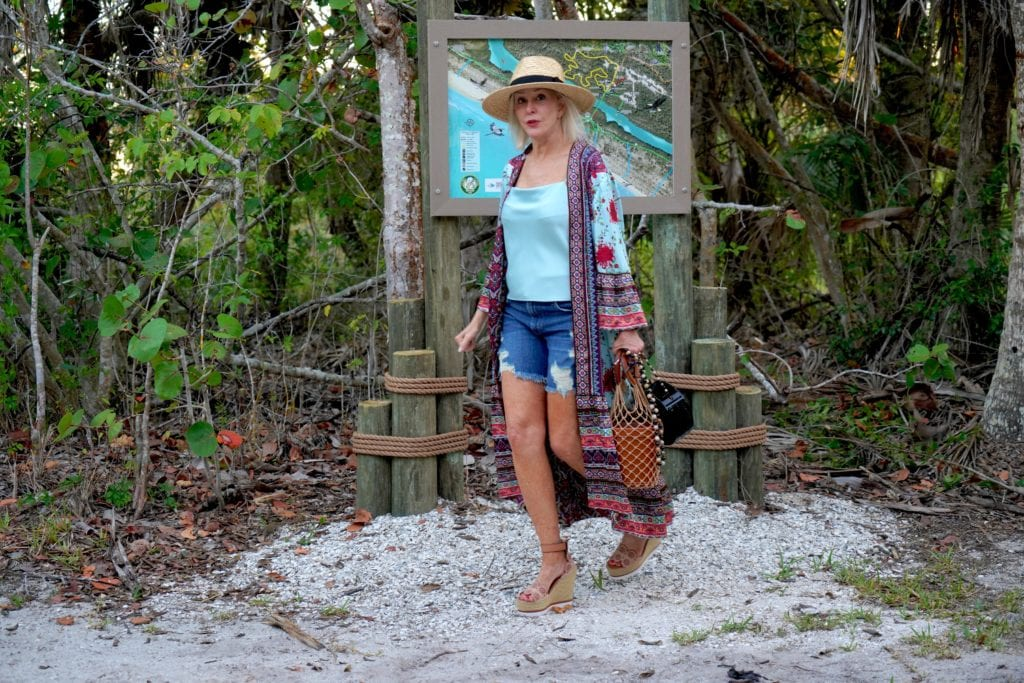 blue camisole, denim shorts with boho kimono, and hat with espadrilles