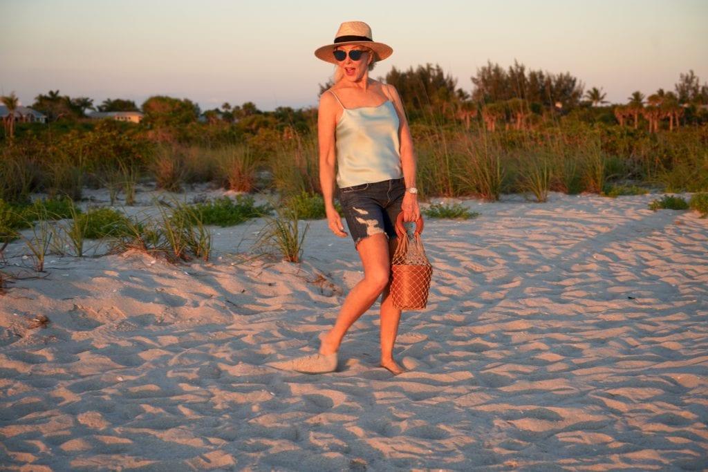 blue camisole, denim shorts wit hat with espadrilles