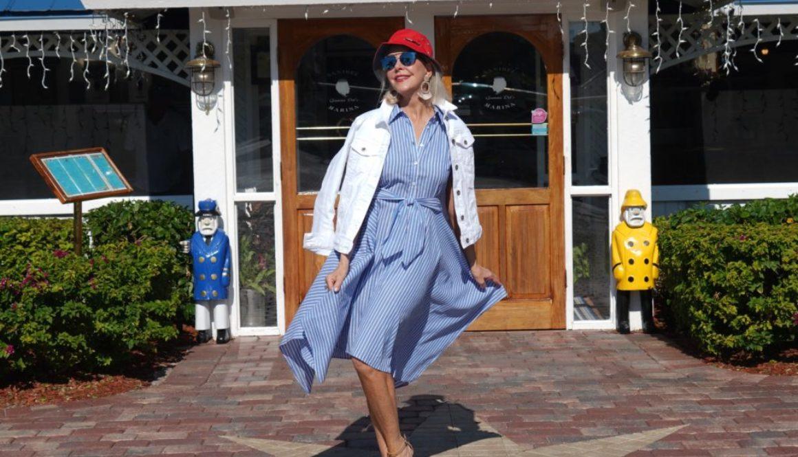 Blue & white stripe dress, red sailor hat, white denim jacket, neutral wedge sandal
