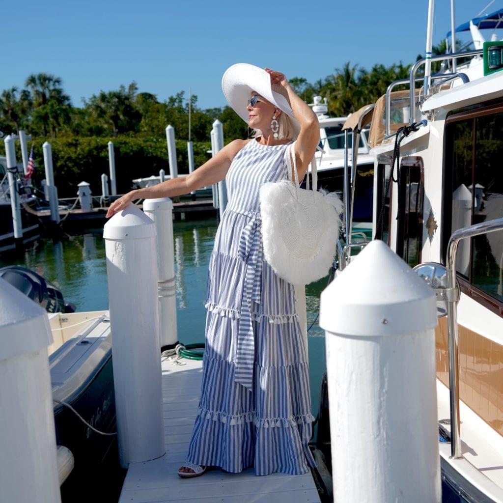 summer maxi dress, marina, boardwalk, big white hat. white yacht, large white tote bag