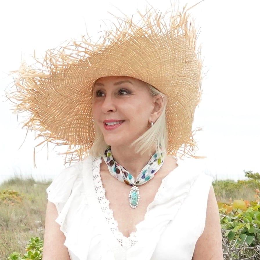 Large straw hat with fringe, white dress