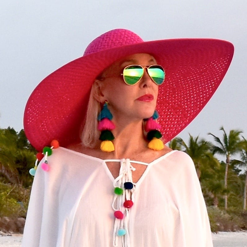large wide brimmed hot pink hat with swimsuit coverup