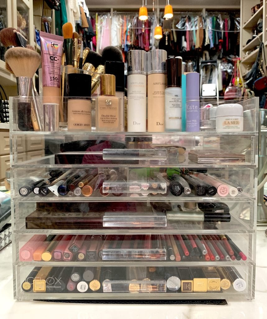 acrylic makeup storage with assorted makeup,