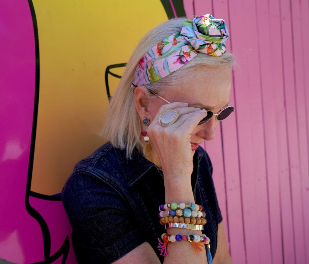 Sheree of the SheSheShow wearing wide floral headband small oval sunglasses