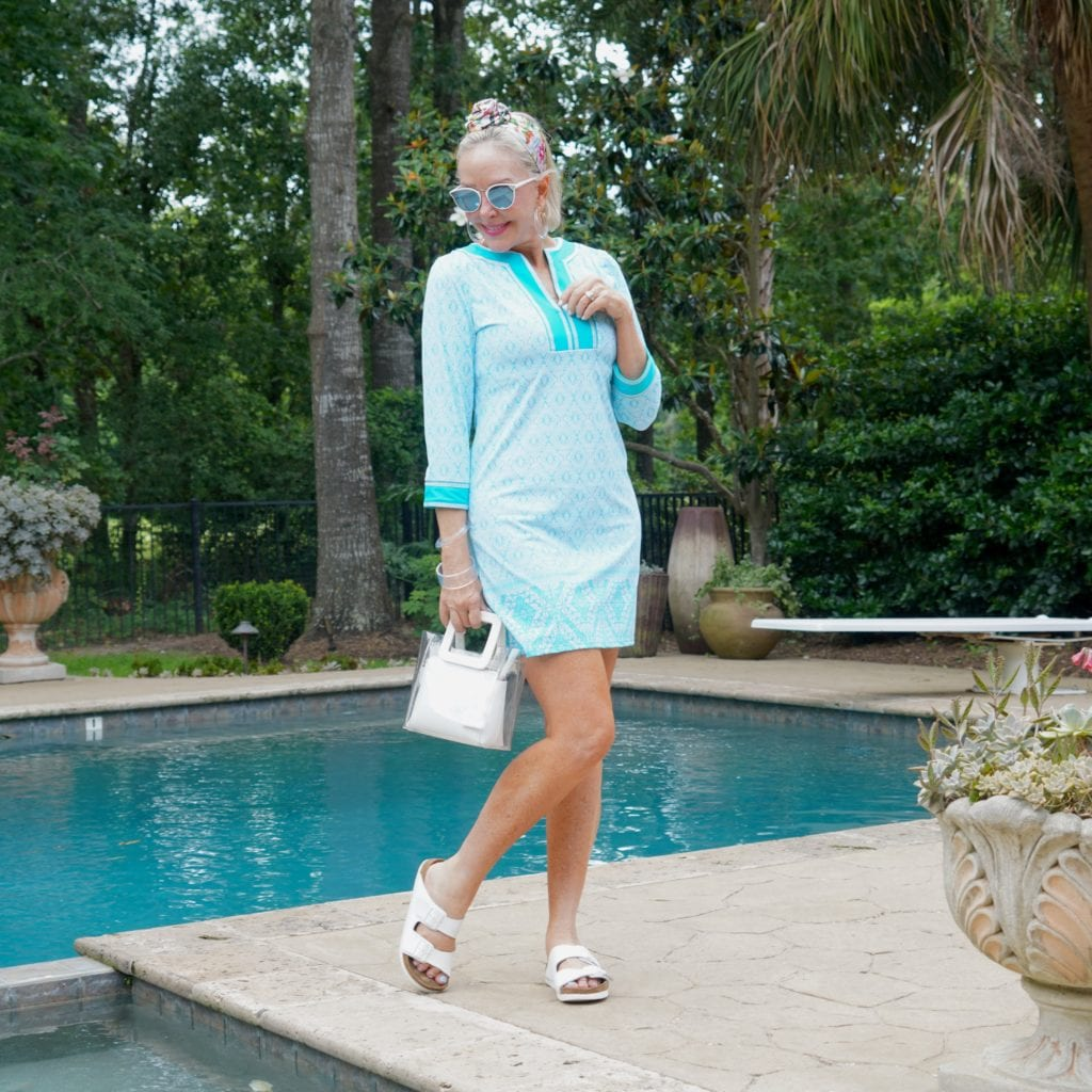 Sheree Frede of the SheShesShow wearing UPF clothing.UPF turquoise dress by the pool