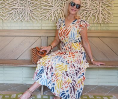 Sheree Frede of the SheShe Show wearing a colorful print summer dress