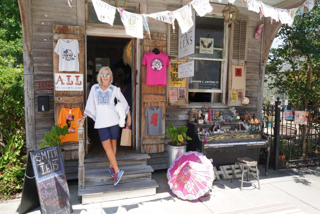 Sheree standing in front of old building with antiques on front porch