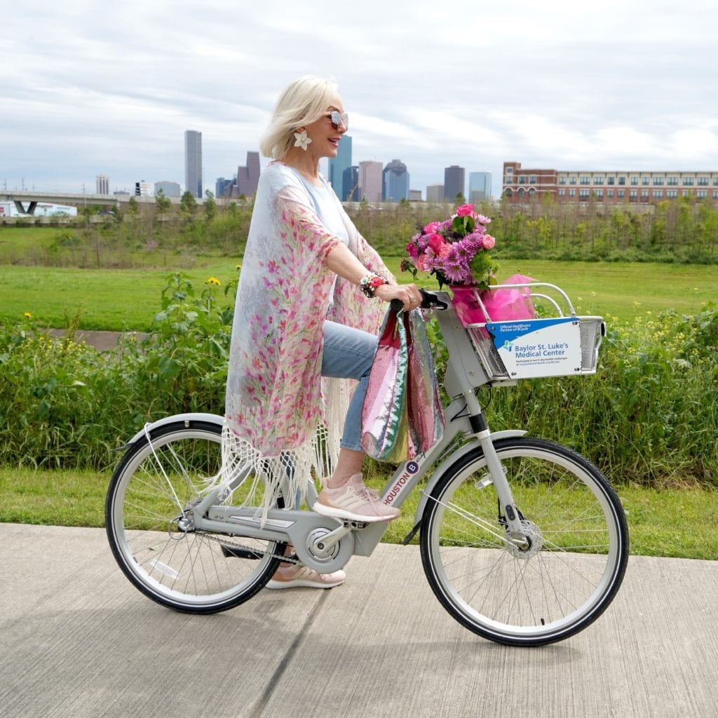 Sheree Frede of the SheSheShow riding bicycle