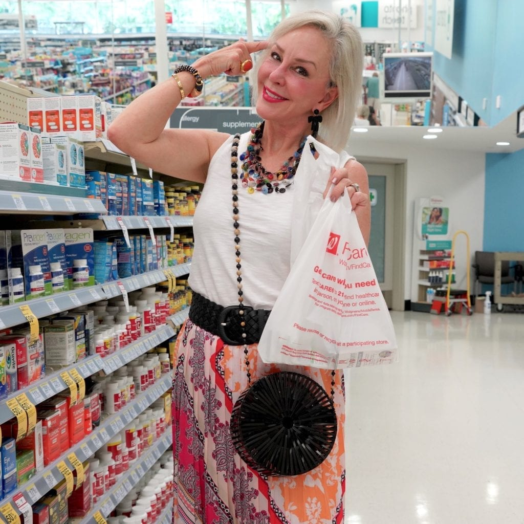 Sheree Frede+SheSheShow+wearing pink print skirt shopping for Natrol Cognium supplement