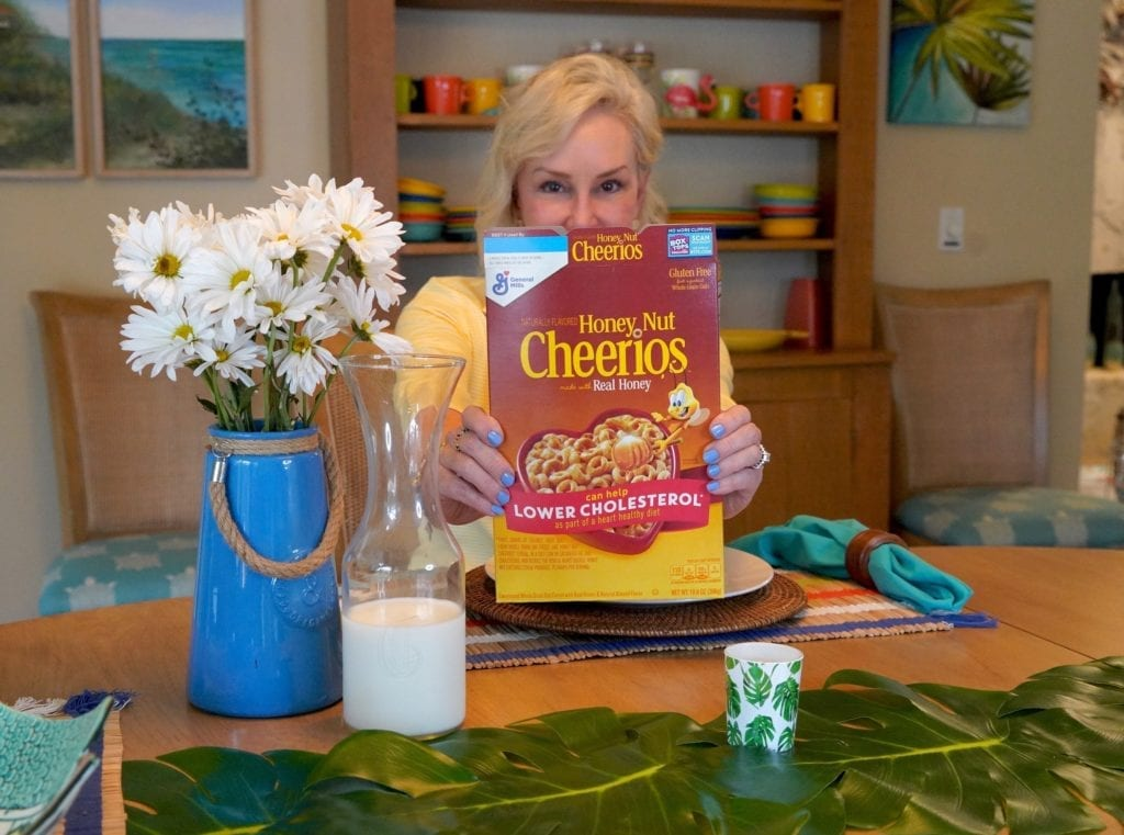 Sheree Frede at breakfast table eating Cheerios