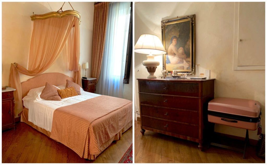 bed with canopy and chest in Boutique Hotel in Piazza della Signoria