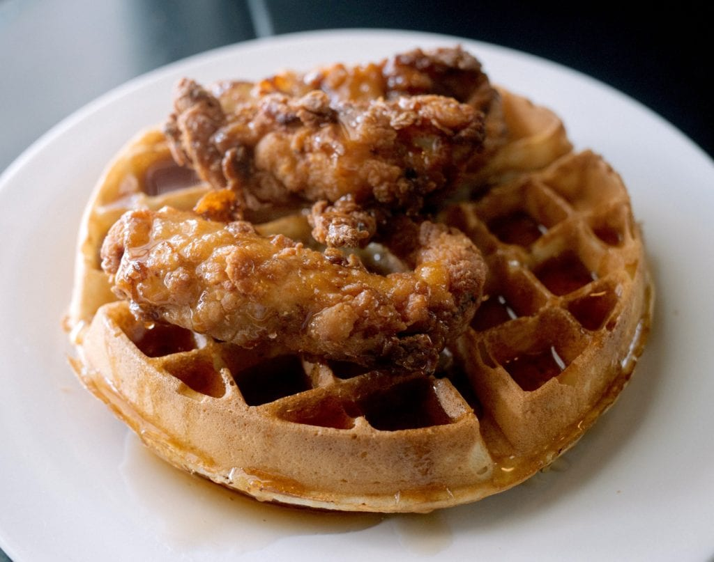 burger, fried chicken on waffle, sign and white house with front porch, Mockingbird Cafe