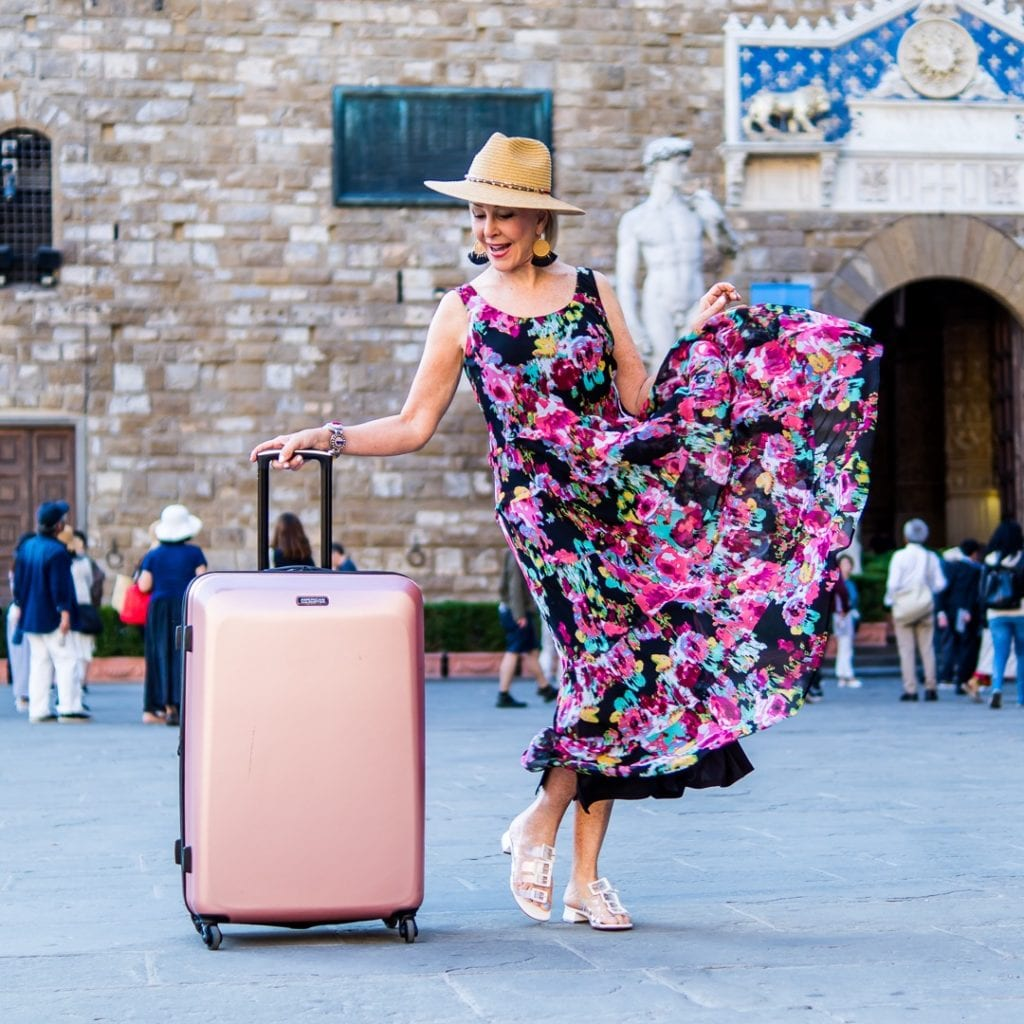 Sheree Frede of the SheSheShow with her metallic rose American Tourister bag in Florence piazza