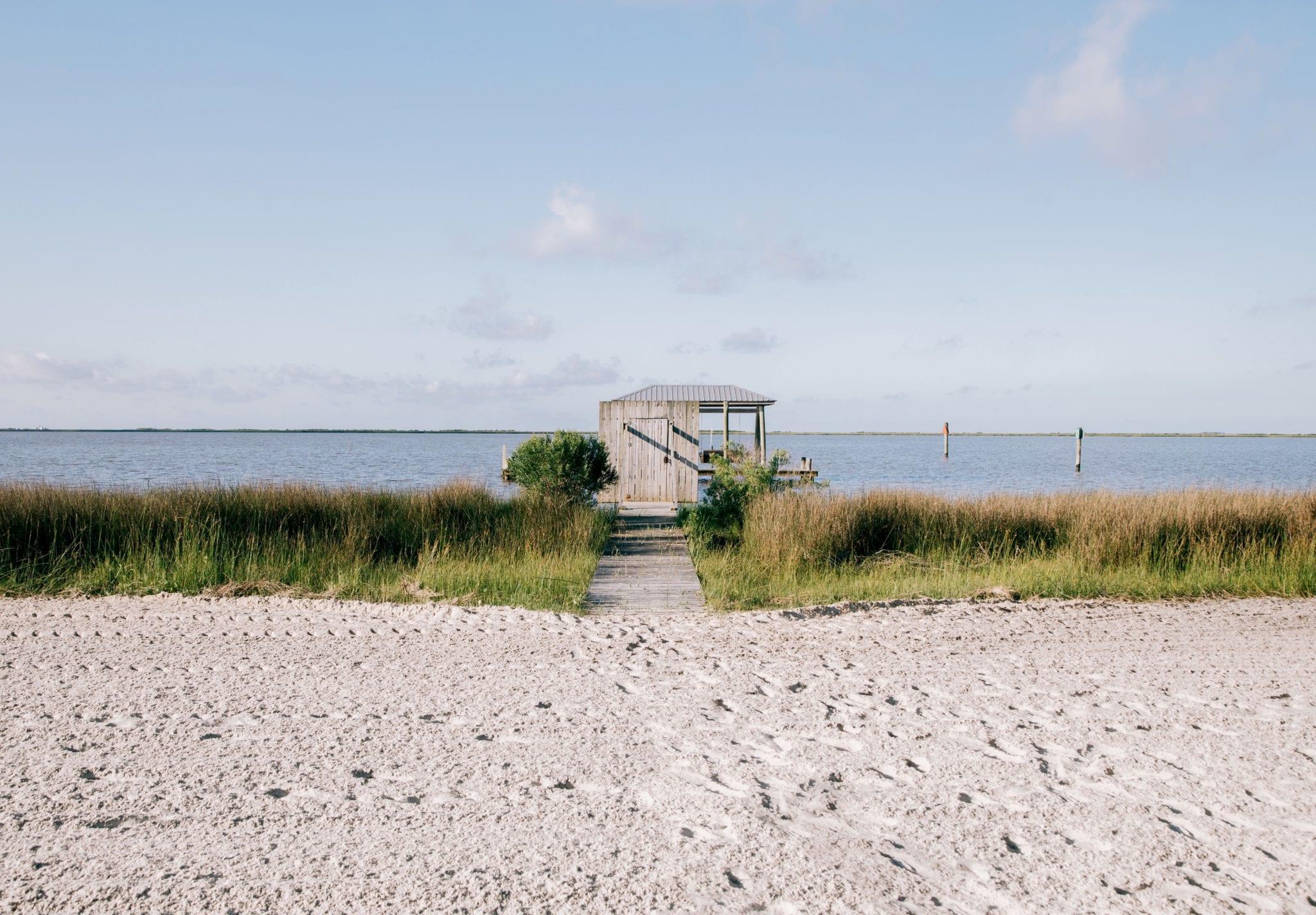 Sand beach old shack Mississippi Sound