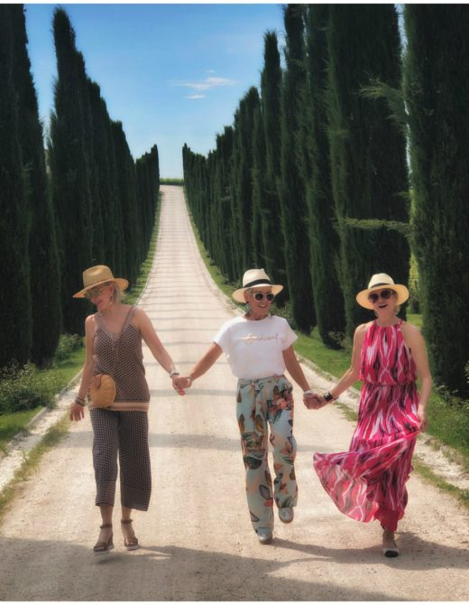 Road lined with Italian Cypress tress, SheShe Show, Chic Over 50, More Turquoise walking down the road