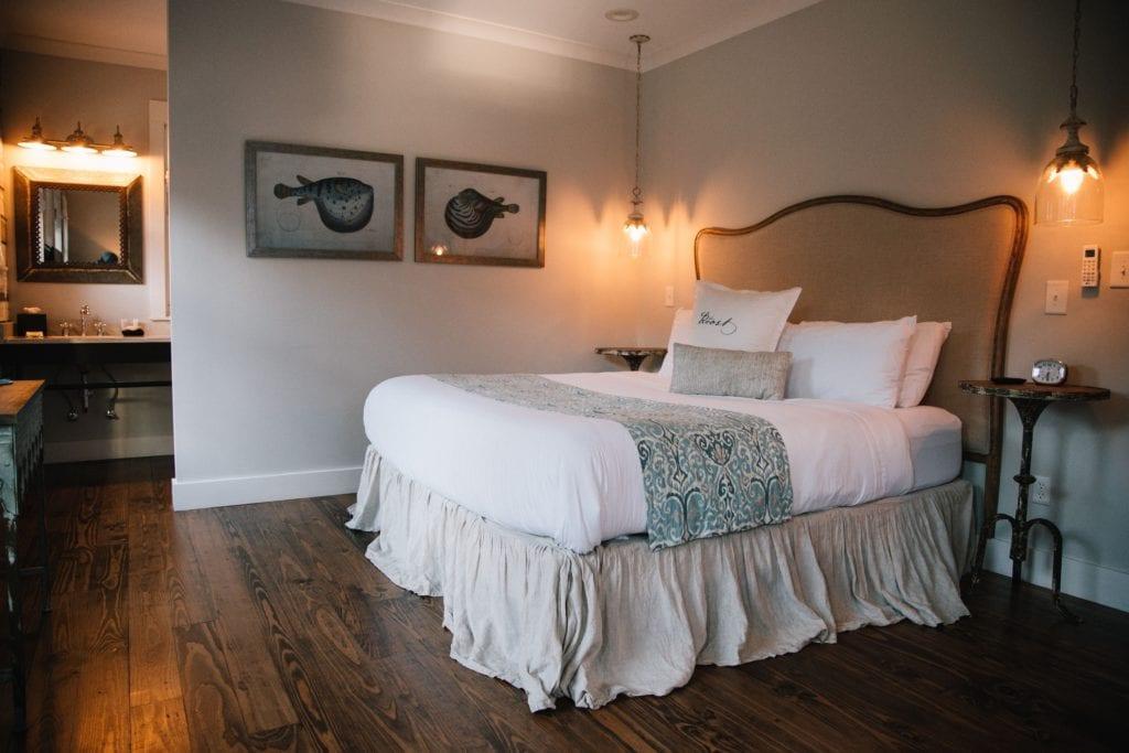 queen bed with antique headboard