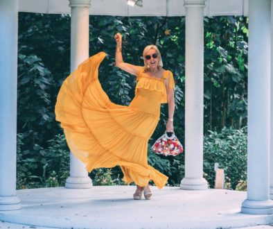 Sheree of the SheShe Show wearing a yellow maxi dress