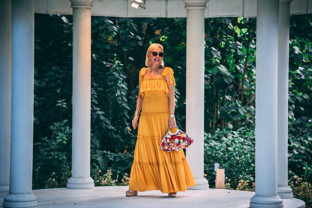 Sheree of the SheShe Show wearing a yellow maxi dress