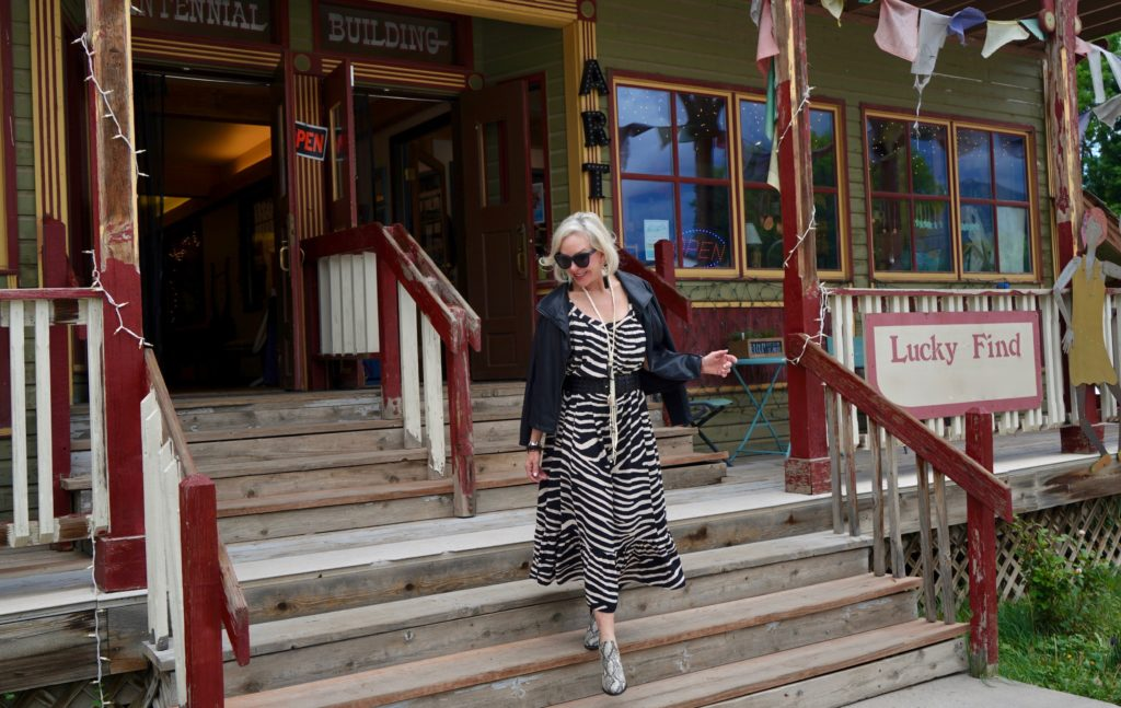 SheShe of the SheShe Show wearing zebra print maxi dress with leather bomber jacket in old western downtown