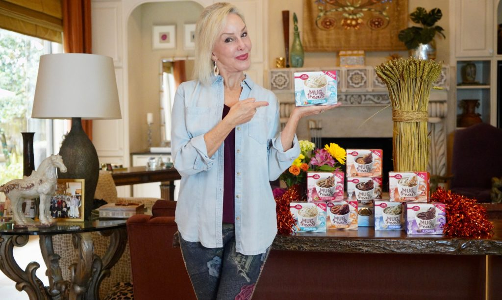 Sheree of the SheShe Show holding Betty Crocker Mug Treat box
