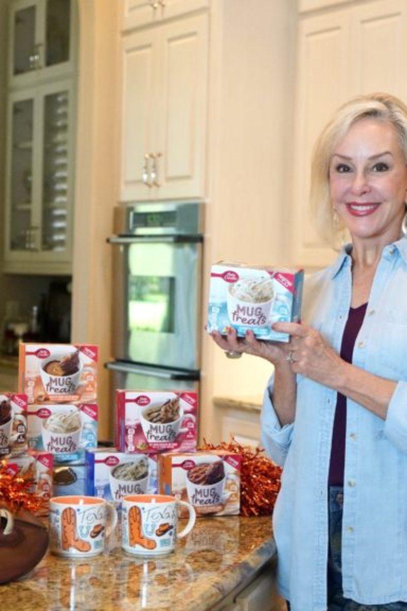 Sheree of the SheShe Show holding Betty Crocker Mug Treat box
