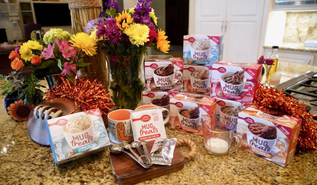 Counter with a variety of Betty Crocker Mug Treats in the box