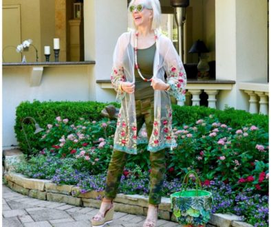 Sheree Frede of he SheShe Show wering camo pants with sheer floral kimono