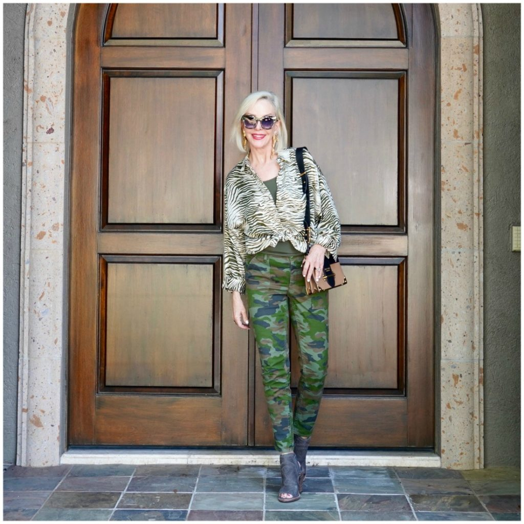 SheShe of the SheShe Show wearing camo pants and zebra top.