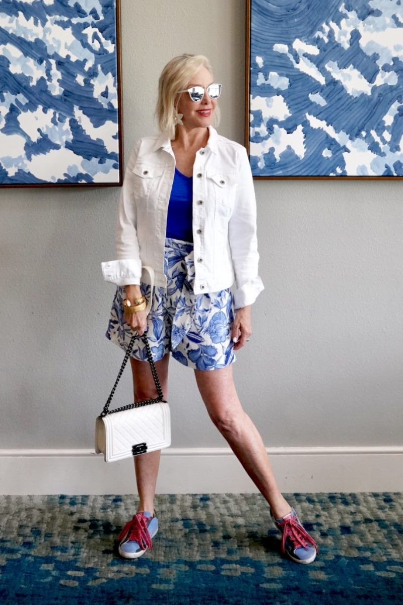 SheShe of the SheShe Show wearing bule and white print paper bag style short with white denim jacket
