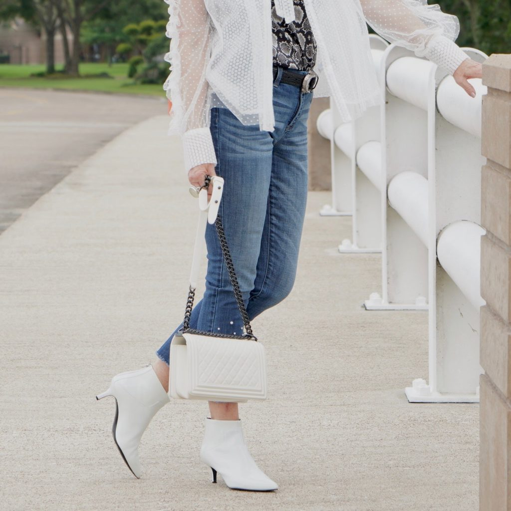 white patton kitten heel booties worn with jeans and white top