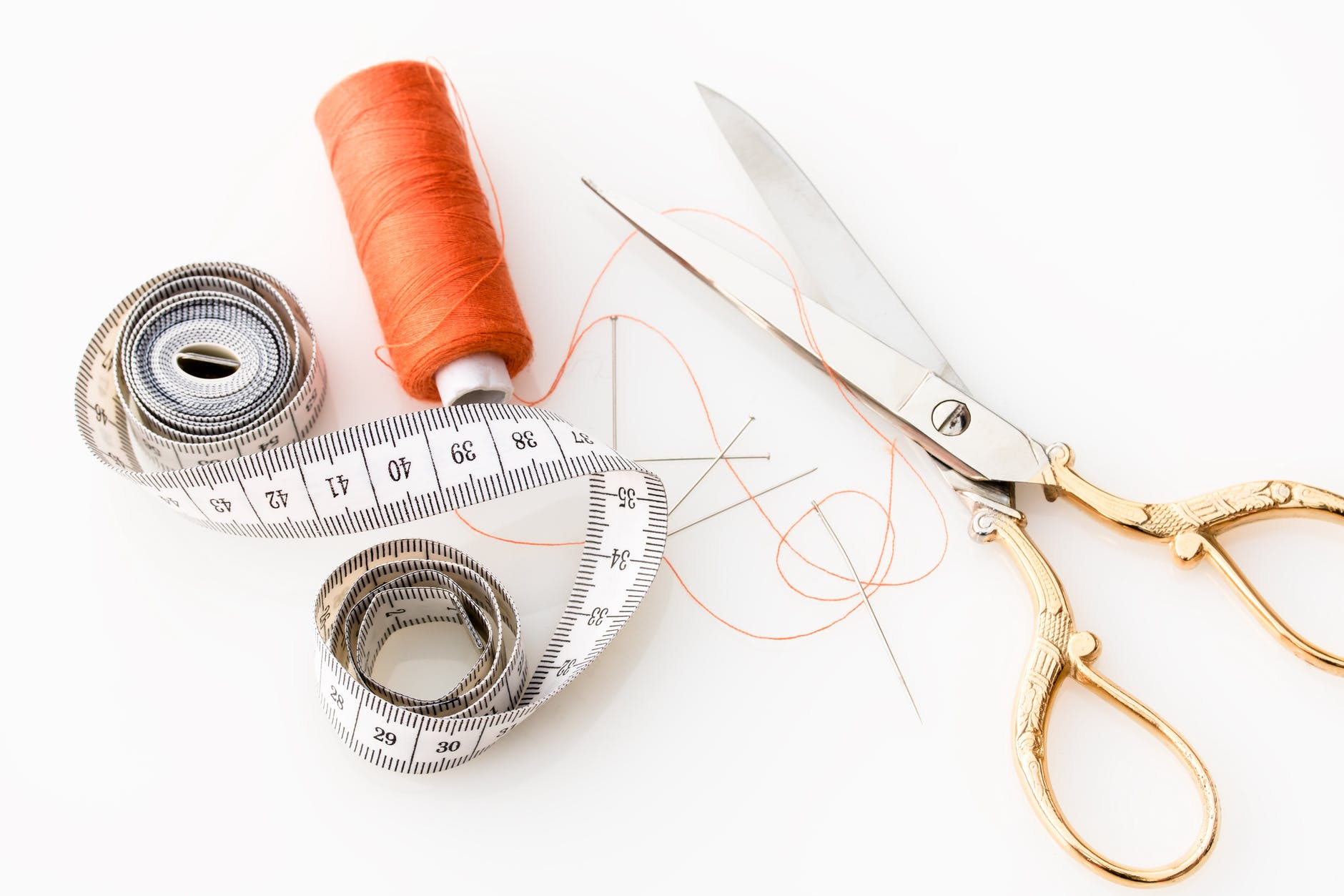 scissors, measuring tape, thread