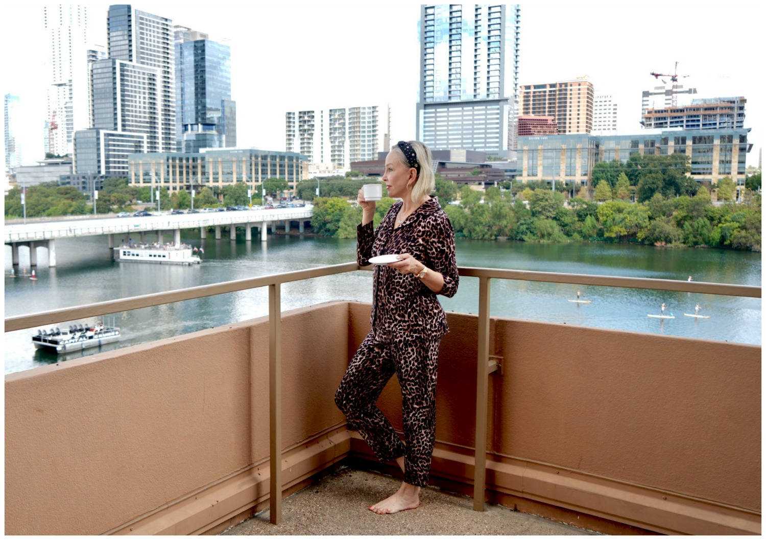 SheShe of the SheShe Show wearing leopard pj's on lake balcony in Austin