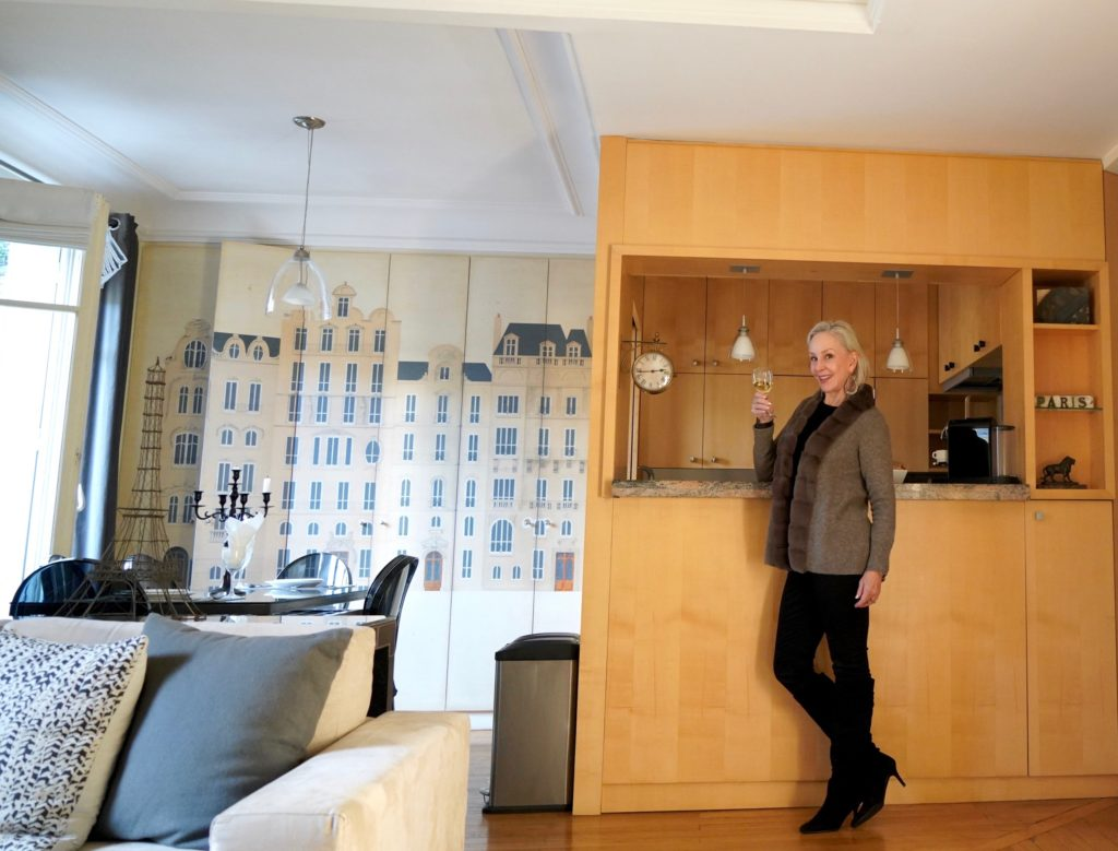 Sheree Frede of the SheShe Show standing at kitchen bar in kitchen and dining room
