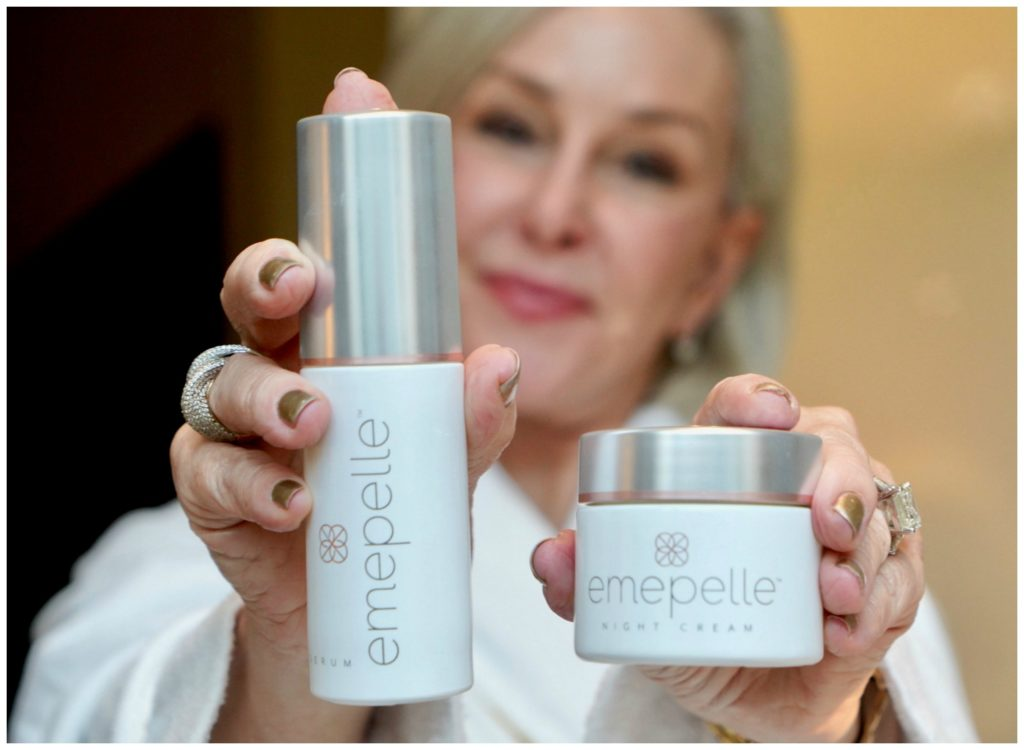 Sheree Frede of the SheShe Show sitting at vanity holding Emepelle cream