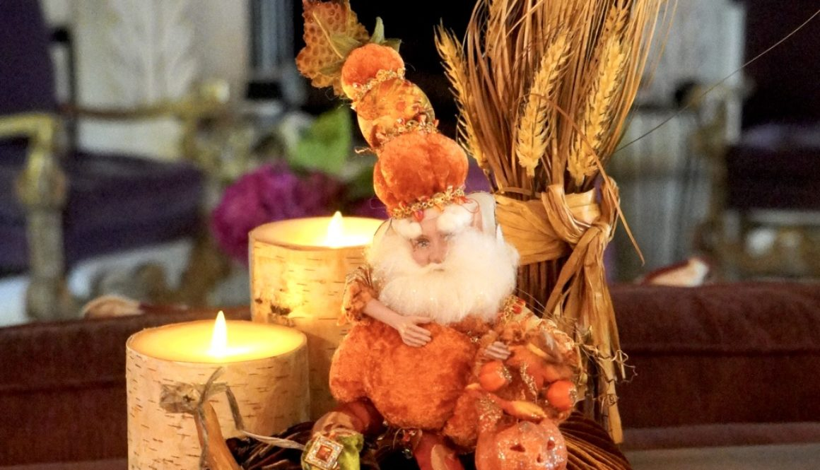 Fall decor with pumpkins, candles and fairy