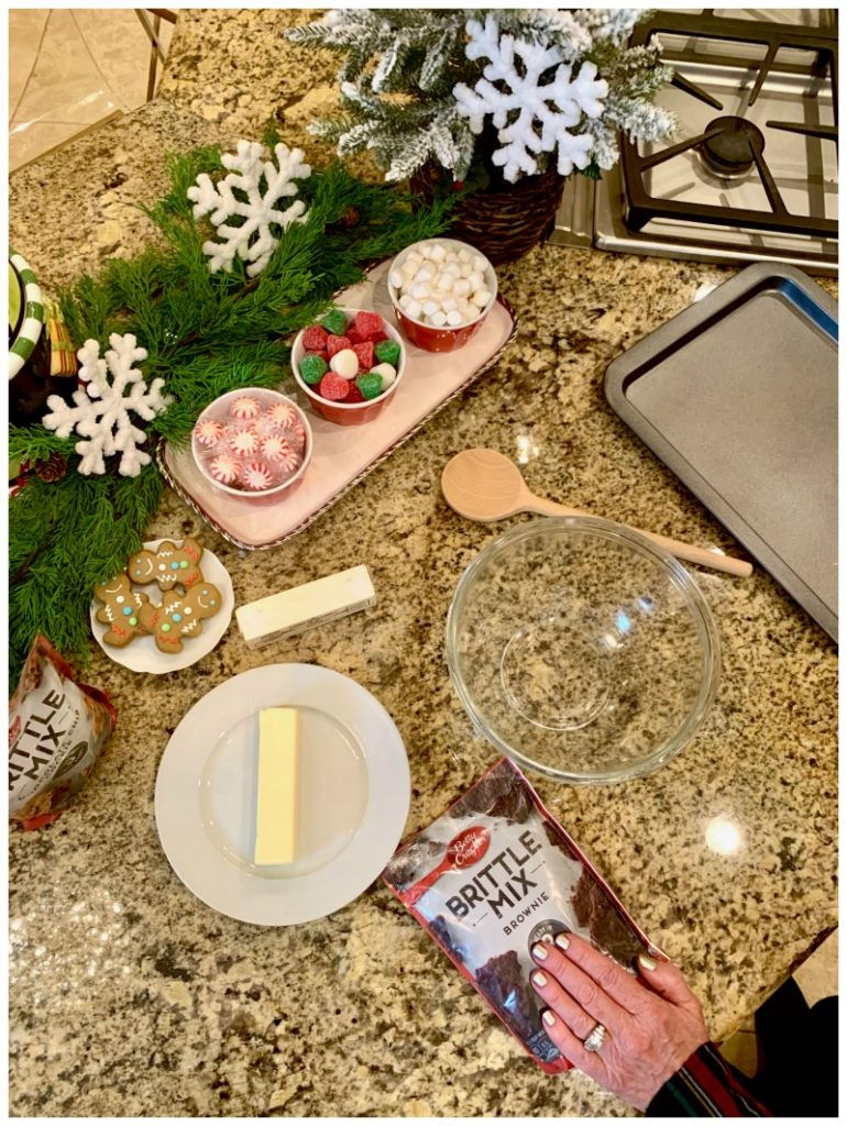 clear mixing bowl, Betty Crocker Brittle Mix, plate with stick butter and baking sheet