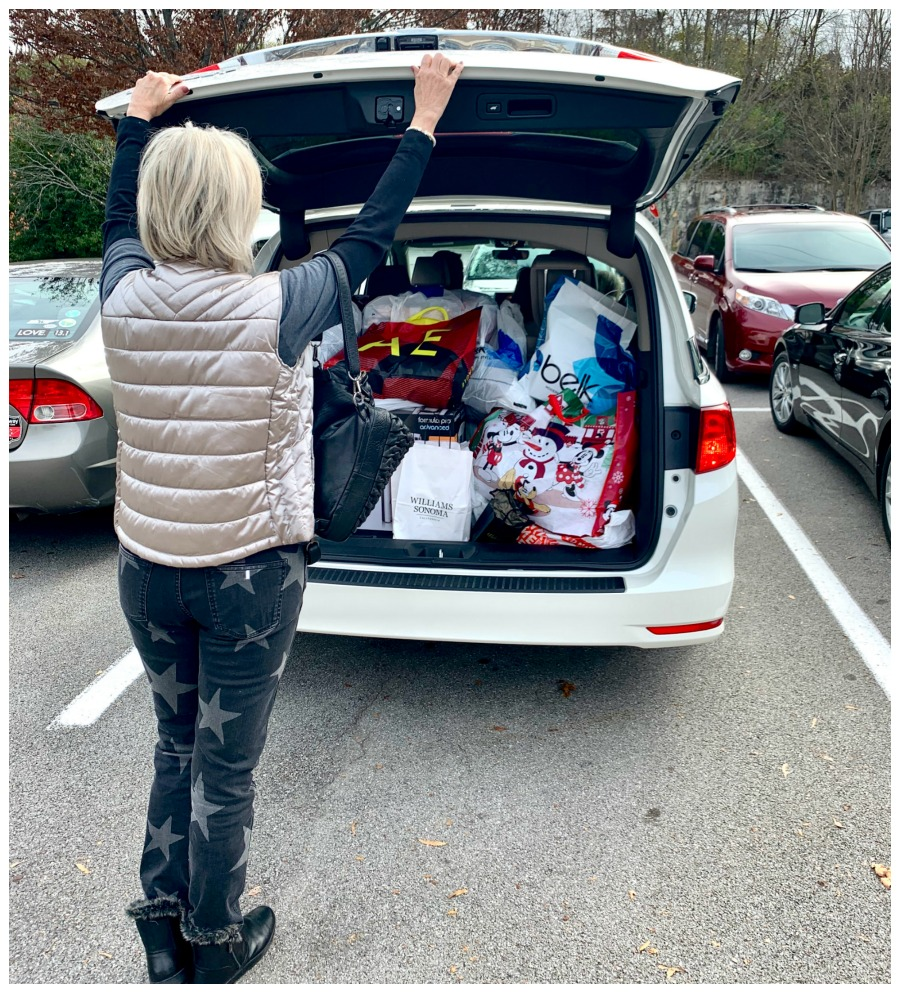 Sheree Frede cloing up the back of an suv loaded with packages