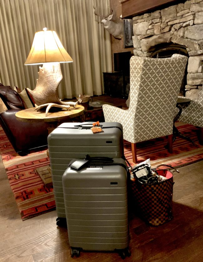 2 Suitcases sitting in hotel room