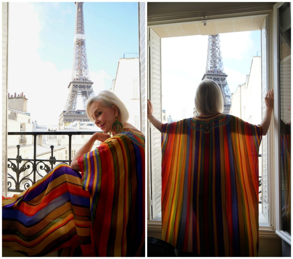 Sheree of SheShe Show wearing Shahida Kaftan looking out window at the Eiffel Tower in Paris
