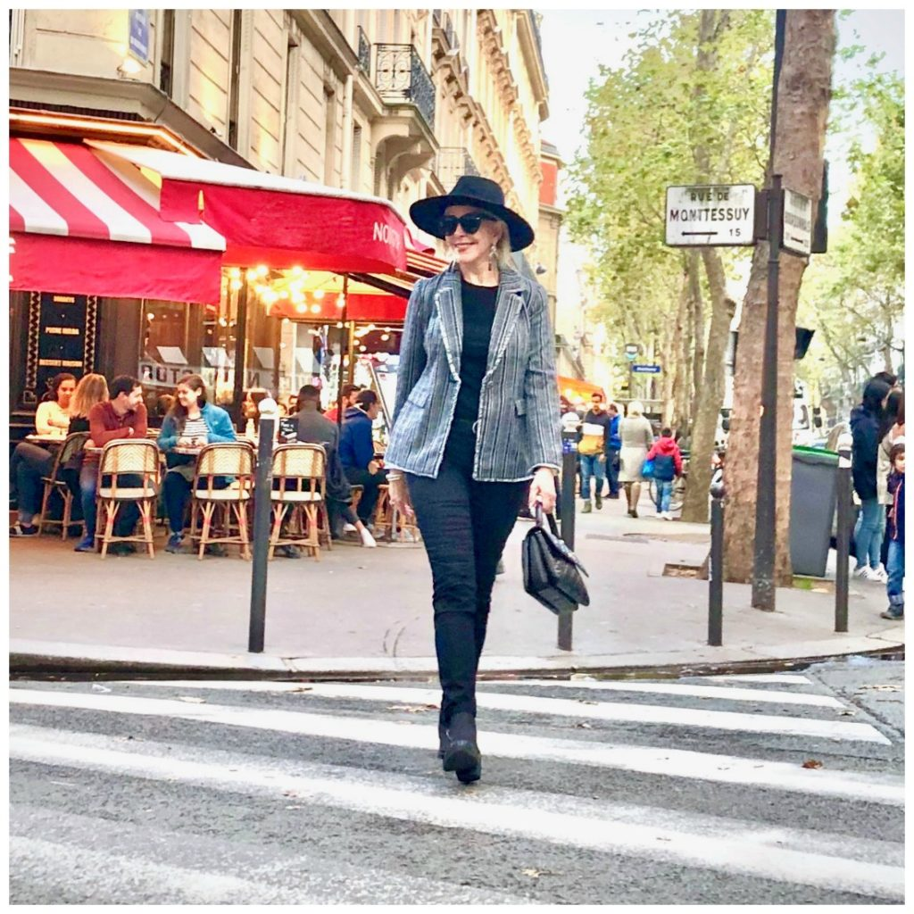 Sheree of sheshe show crossing the street in paris wearing Chico's