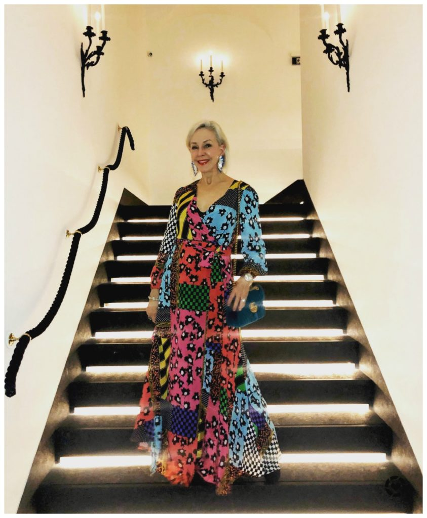 Sheree of SheShe Show wearing Alice and Olivia dress on staircase