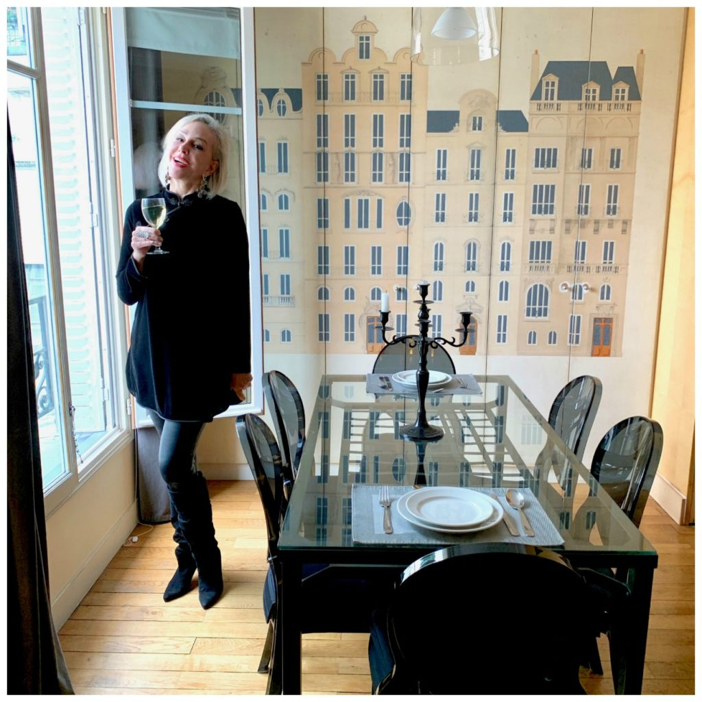 Sheree of SheShe Show wearing soft surroundings clothing line in Paris Perfect apartment