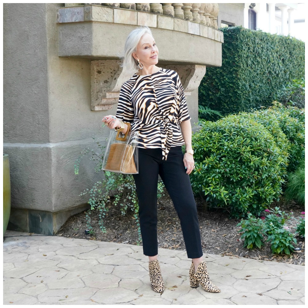 SheShe of the SheShe Show wearing a zebra top over black pants