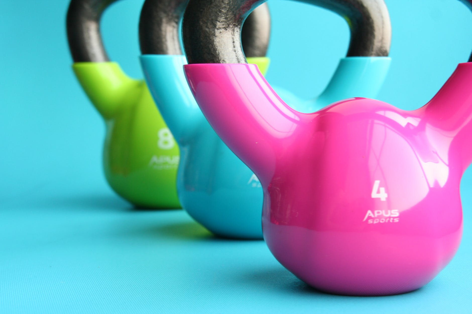 pink, bule and green kettle ball for workouts
