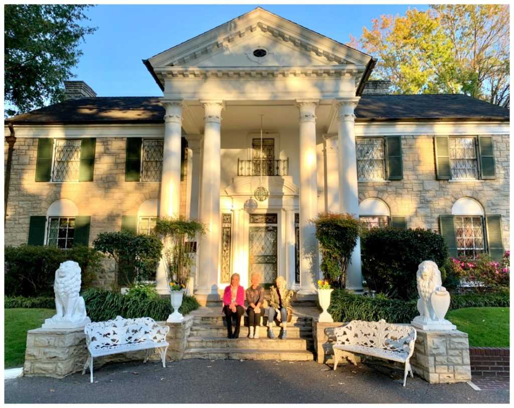 SheShe, Shauna, and Jamie sitting in front of Graceland Mansion in Memphis, Tennessee
