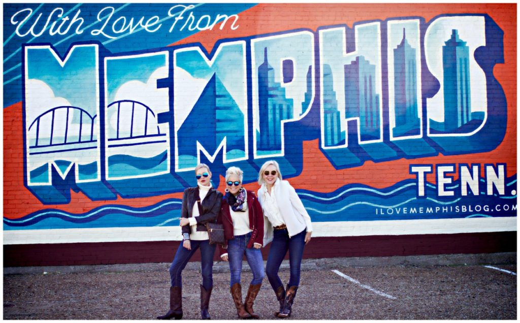 Jamie, Shauna, and Sheree Frede of the SheShe SHow standing in front of Memphis wall mural