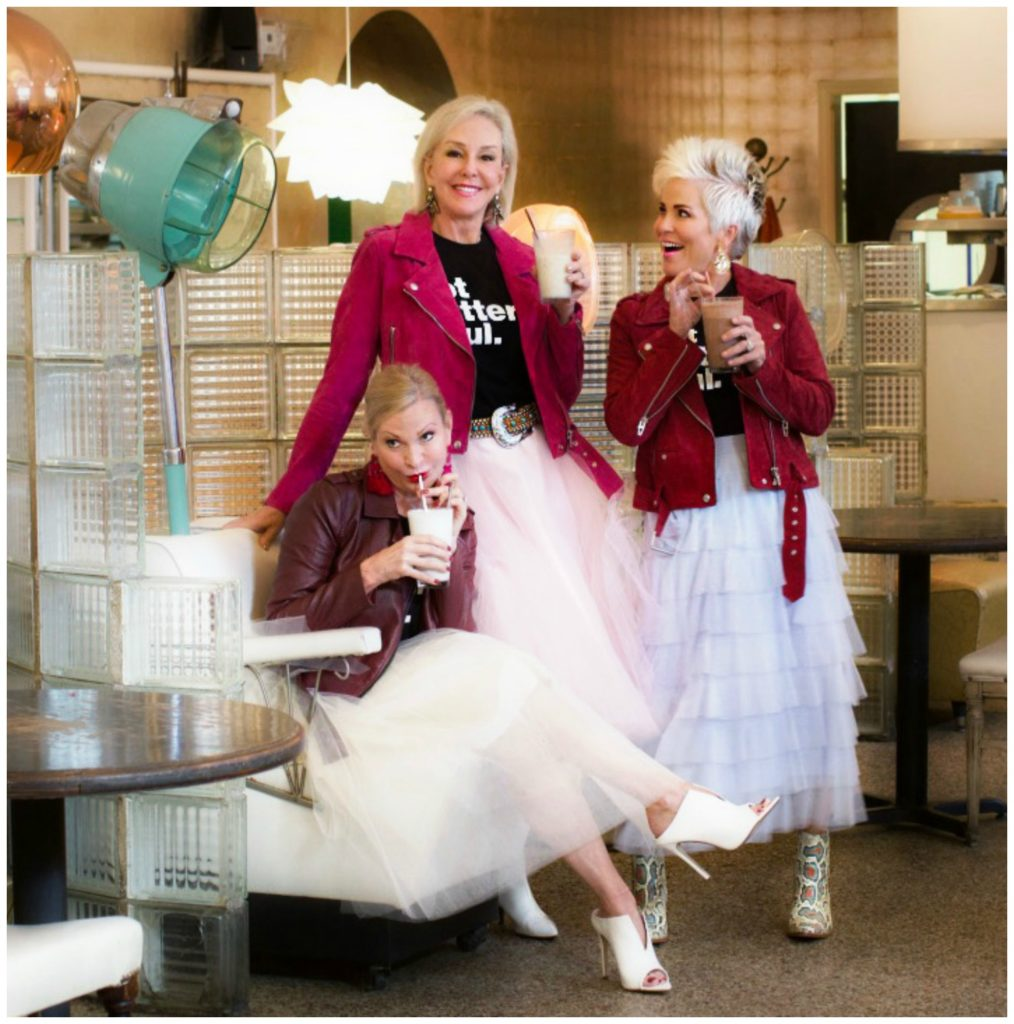 Jamie, SheShe and Shauna wearing pink and tan toole skirts with jackets sipping shakes at the Beauty Shop Memphis, TN.