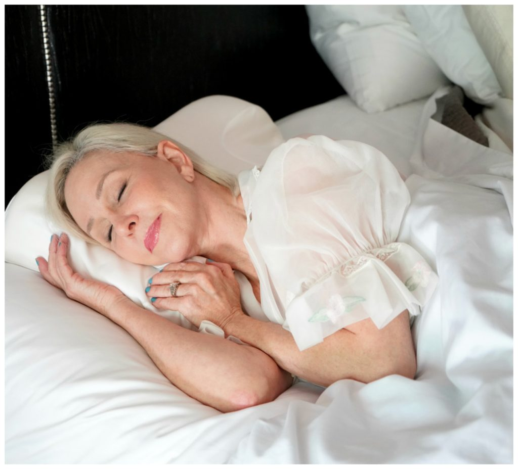 SheShe of the SheShe Show asleep in bed