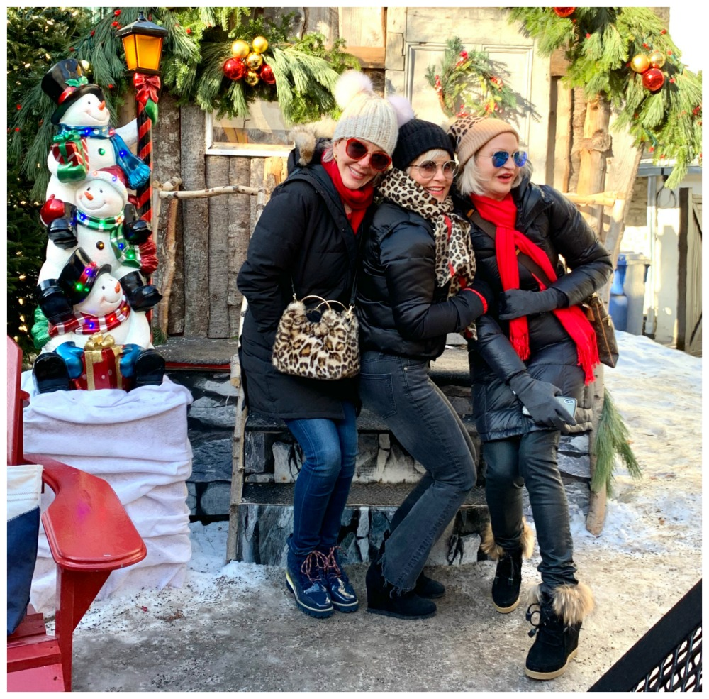 Sheree of SheSheShow, Shauna, Jamie huddled up in the cold at German Christmas Market Quebec City